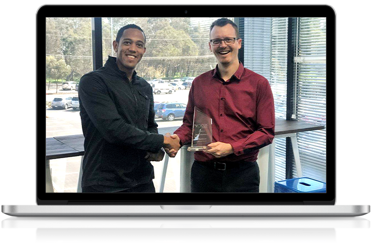 Office Solutions IT director receiving Vocus partner award