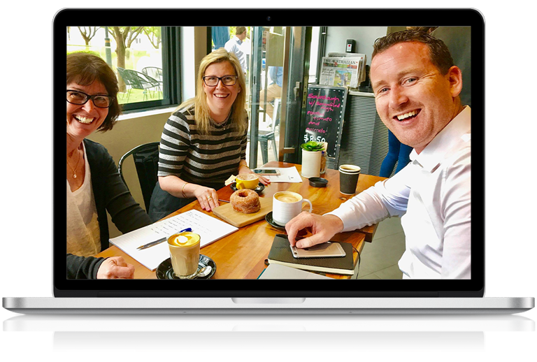 Office Solutions IT manager meeting legal clients at a cafe