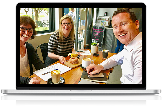Office Solutions IT Manager meeting clients in a cafe